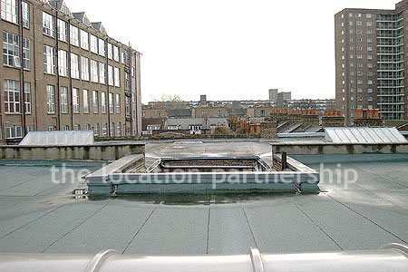 Rooftop view above minimal apartment in east London. NB new building block has been erected. Ask office for more details.