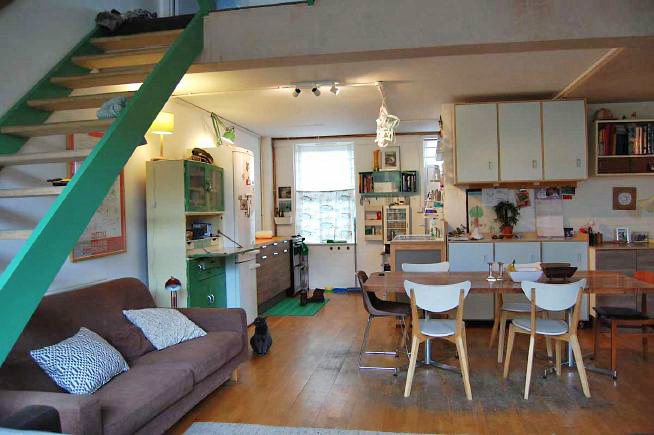 Modern terraced house built as a live/ work studio. Living space is split level with quirky details. Also features a roof terrace with views of the city/ East London.