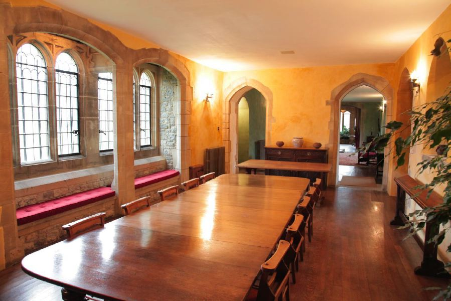 Period dining room with stone mullion windows in a beautiful castle