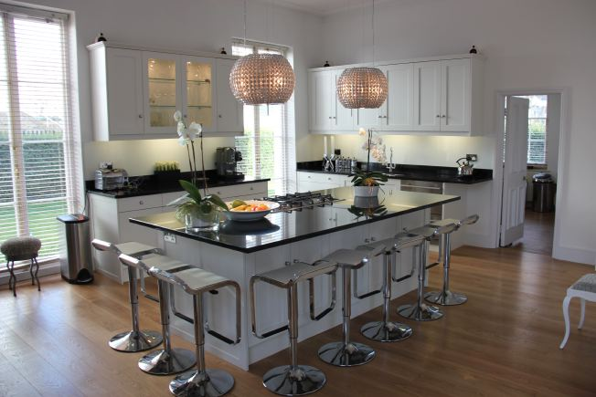 Large modern designer kitchen - very light and airy and open plan. NB- stills or small shoots preferred.