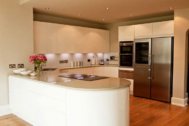 Lovely, light clean lined kitchen with bi-folding doors opening onto the garden.