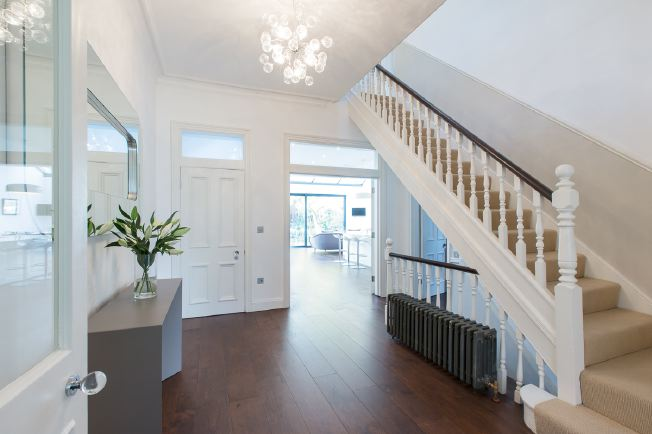 Wide entrance hall, stairs and landings in modernised Victorian house.