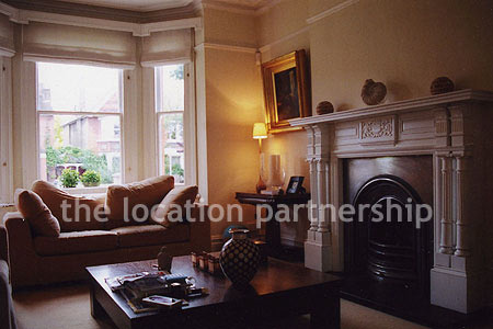 Living Room on Converted Victorian Family House With Through Living Room And A