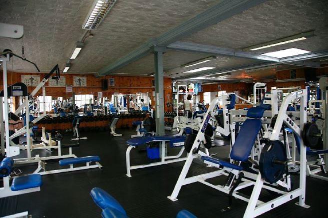 Large body-building gym with loads of character. NB